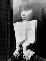 dreamy girl with book out window