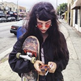 teen witch on phone and skate board
