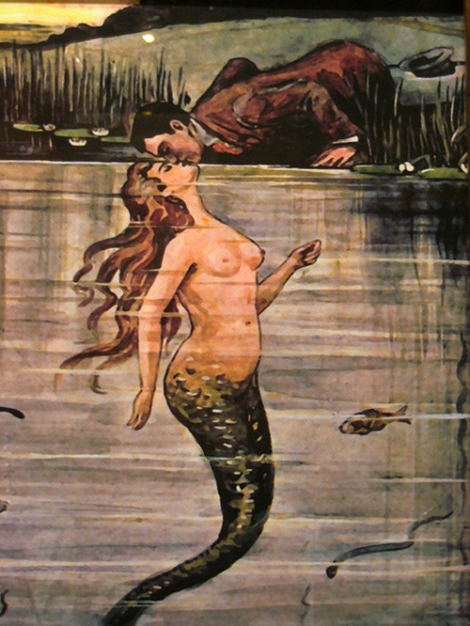 mermaid with man kissing