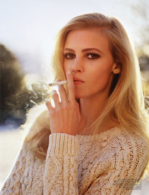 Lara Stone smoking a cigarette (or weed)