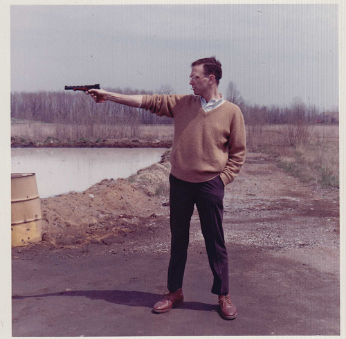 Men in Sweaters Shoot Guns