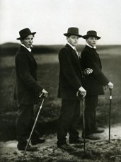 Three Men Travel Time - Dressed in Black with hats and canes- Watch out
