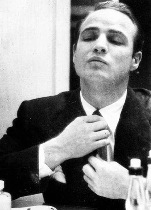 EOF Getting Down To Business Fashion- Marlon Brando Ties His Tie