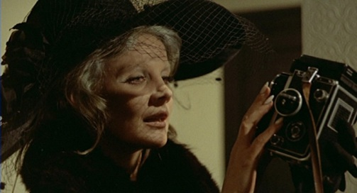 Baba Yaga 1973- carroll baker holds the eye that freezes time