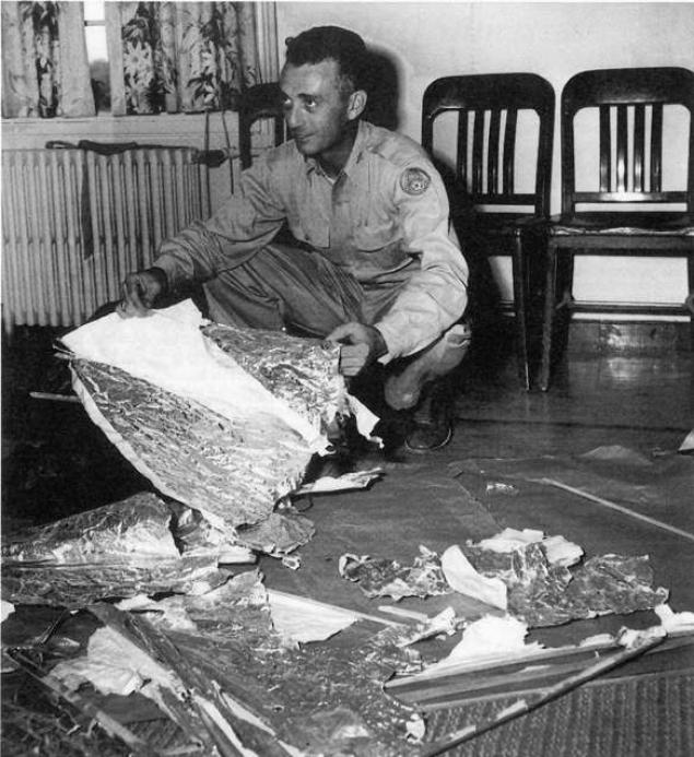 Photograph of Army Guy Sorting Through Roswell Debris - flying saucer- vintage- 1948