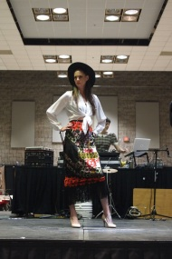 Kara wears a white EATON blouse and a vintage LANVIN graphic fringed skirt from THE EYE OF FAITH