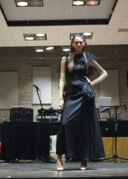 Kara is stelllar wearing a black feathered evening gown from VINTAGE SOUL GEEK