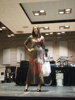 Tess G. wears a 70s floral metallic maxi from HAWK & SPARROW